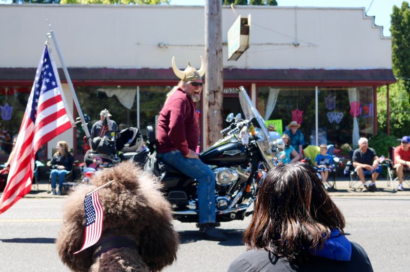 TRIBUNE PHOTO: ZANE SPARLING - A man on a motorcycle entices the crowd during the start of the St. Johns Parade on Saturday, May 12 in Portland.