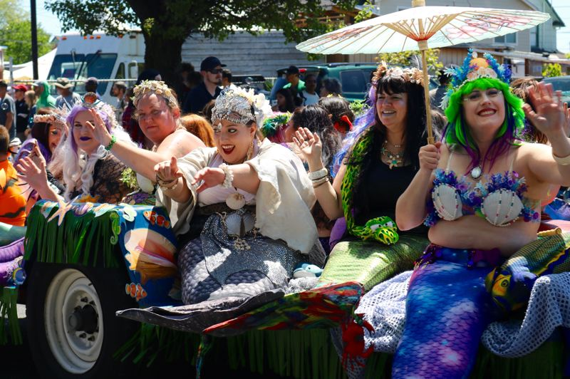 TRIBUNE PHOTO: ZANE SPARLING - Mermaids smile and wave during the 56th annual St. Johns Parade in Portland on Saturday, May 12.