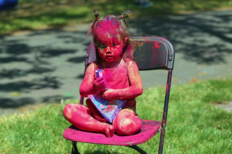PMG PHOTO: JESSICA DARLAND - Greta Franck, 2, of Portland takes the Indian Festival of Color very, very seriously during Saturday's Rang Barse celebration in Hillsboro.