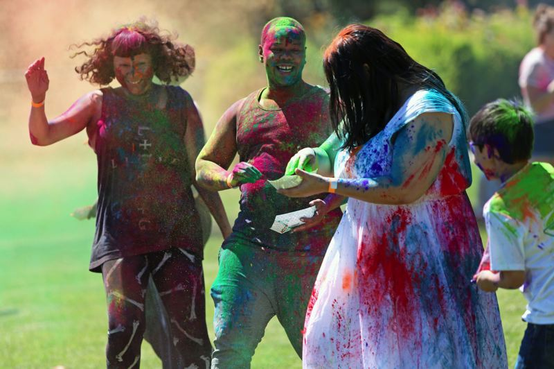 PMG PHOTO: JESSICA DARLAND - Portlanders Selena Varela, left, and Jordan Hornaday, to her right, heard about the Holi celebration and came to dance.