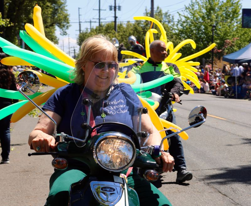 TRIBUNE PHOTO: ZANE SPARLING - Motorcyclists circle the street during the St. Johns Parade on Saturday, May 12 in Portland.