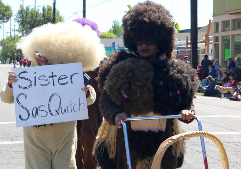TRIBUNE PHOTO: ZANE SPARLING - Anda Vaugh Fitzgerald (right) said it's time for afro sasquatches to step out of the shadows during the annual St. Johns Parade in Portland on Saturday, May 12.