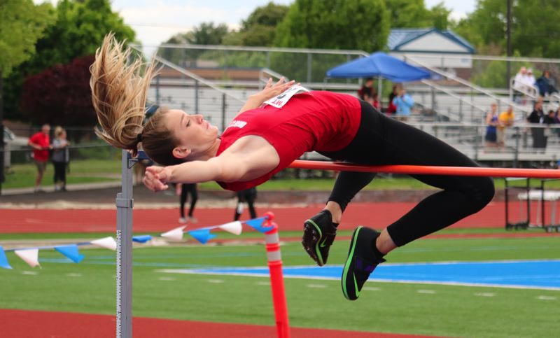 PAMPLIN MEDIA PHOTO: JIM BESEDA - Oregon City's Kylie Griffin cleared 5 feet, 6 inches to win the girls' high jump Tuesday and tie the meet record at the Mt. Hood Conference track and field championships in Gresham.