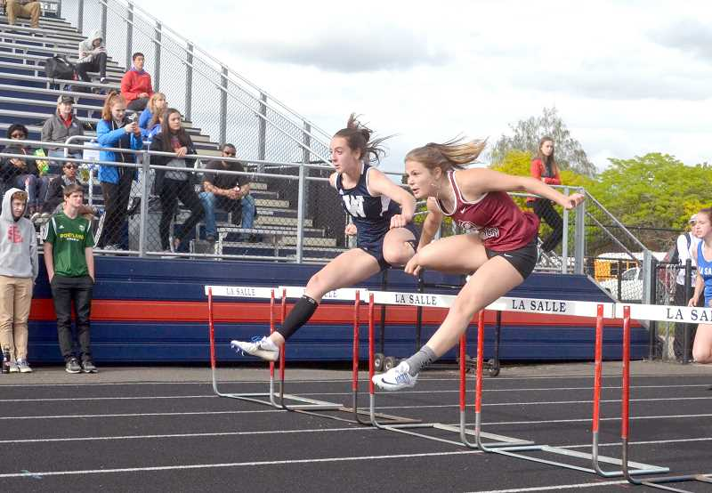 SPOKESMAN PHOTO: TANNER RUSS - Emily Scanlan took first place in the 100-meter hurdles with a personal record 15.99 seconds.