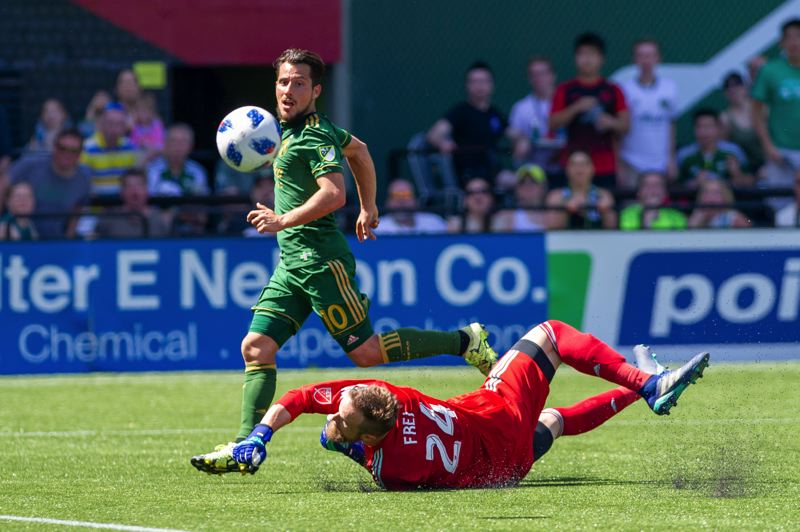 TRIBUNE PHOTO: DIEGO G. DIAZ - Sebastián Blanco chips the ball over Seattle Sounders goalkeeper Stefan Frei to score in the 86th minute of the Portland Timbers' 1-0 victory Sunday afternoon at Providence Park.