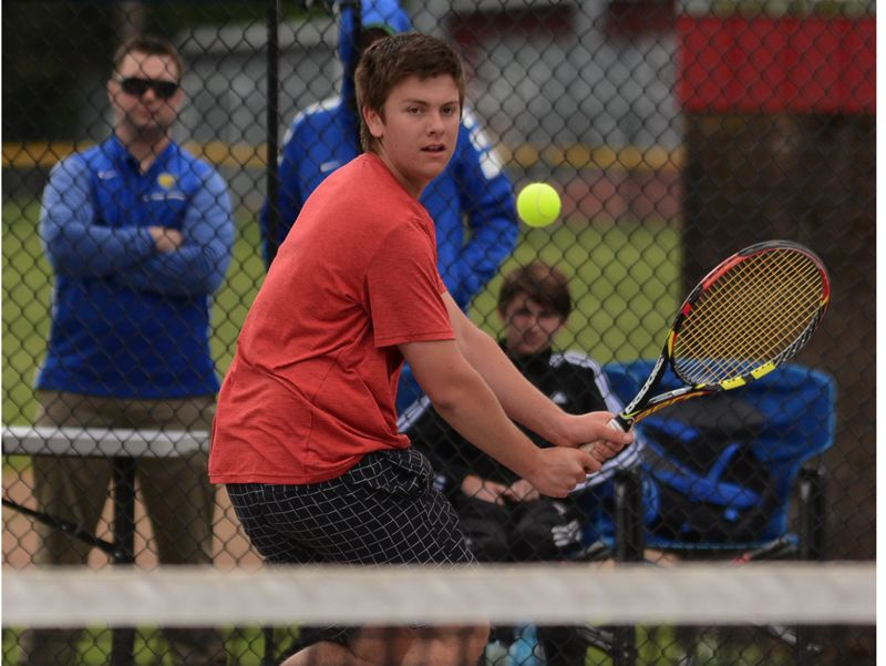 PAMPLIN MEDIA PHOTO: DAVID BALL - Oregon City's Michael Perez fell 6-1, 6-1 to Barlow's Christian Maxey in the boys' singles final at Wednesday's Mt. Hood Conference tennis championships at David Douglas High School.