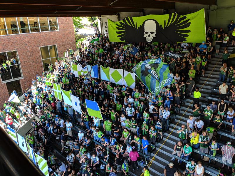 PAMPLIN MEDIA GROUP: JOSEPH GALLIVAN - Seattle Sounders traveling support in confident mood before Sunday's clash with the Portland Timbers. The SOS has not gone out yet, but fans were not happy with another loss.