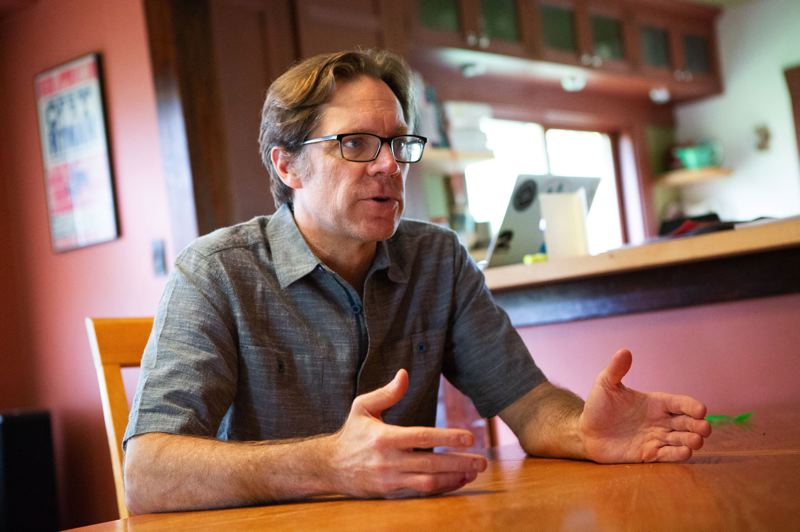 TRIBUNE PHOTO: ADAM WICKHAM - Baseball author Rob Neyer, at his home in St. Johns, has a new assignment: commissioner of the West Coast League, which includes the Portland Pickles.