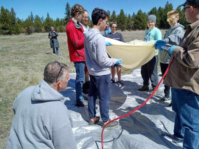 CONTRIBUTE PHOTOS: BOY SCOUT TROOP 544 - Gresham-based Boy Scout Troop 544 fill their latex balloon in a field near Brothers, Ore., southwest of Bend.