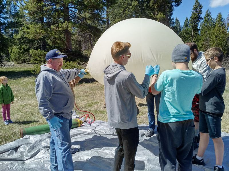 CONTRIBUTE PHOTOS: BOY SCOUT TROOP 544 - The scouts prepare to launch their high-altitude balloon, which would eventually reach 107,000 feet.