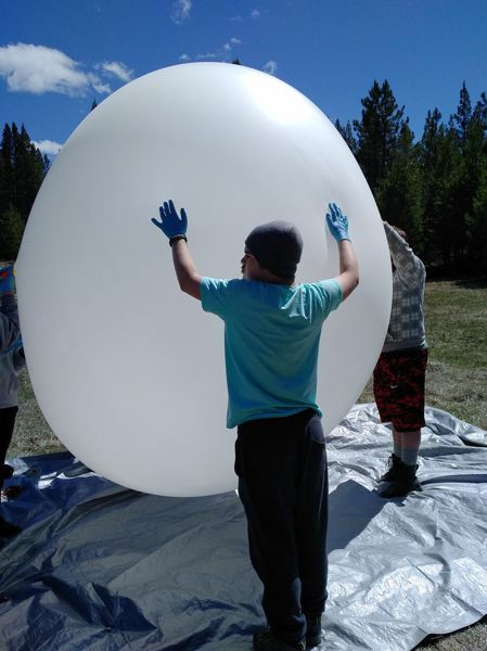 CONTRIBUTE PHOTOS: BOY SCOUT TROOP 544 - The scouts had to wear gloves to protect the balloon from oil and other substances on their hands.