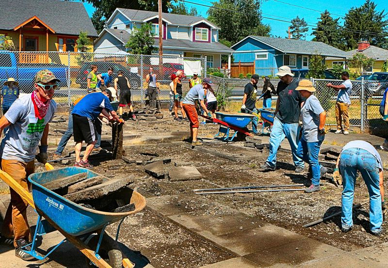 COURTESY PHOTO: SELLWOOD BEE, DAVID F. ASHTON - Volunteers work on a project with Depave at Woodmere Elementary School last year in Southeast Portland.