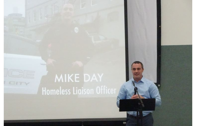 PHOTO COURTESY: LOVE INC - Oregon City Police Officer Mike Day accepts a special award from Love In the Name of Christ of Clackamas County.