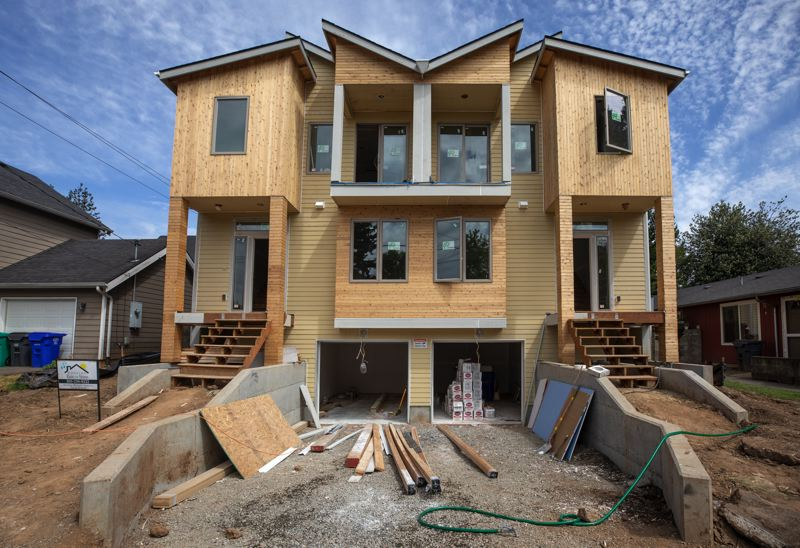 PORTLAND TRIBUNE: JONATHAN HOUSE - A currently under-construction house in North Portland with a scoop-style, shared driveway.