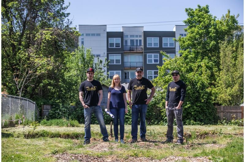 PORTLAND TRIBUNE: JONATHAN HOUSE - From left, Jonathan, Mari, Gary and Chris Ives want to build a duplex on this lot, but they say the Portland Bureau of Transportation gave them unacceptable last-minute required design changes for the units.