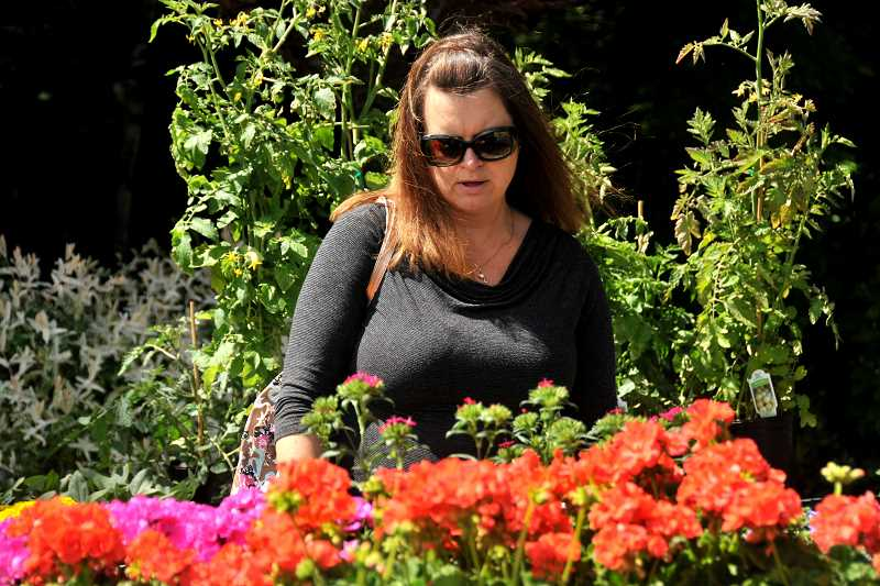 Terri Jones checks out the geraniums.