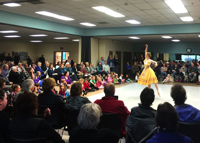SUBMITTED PHOTO - Spectators surround the stage at the Milwaukie Center as Kenzie Brousson dances a solo at last years OBT 2 performance.