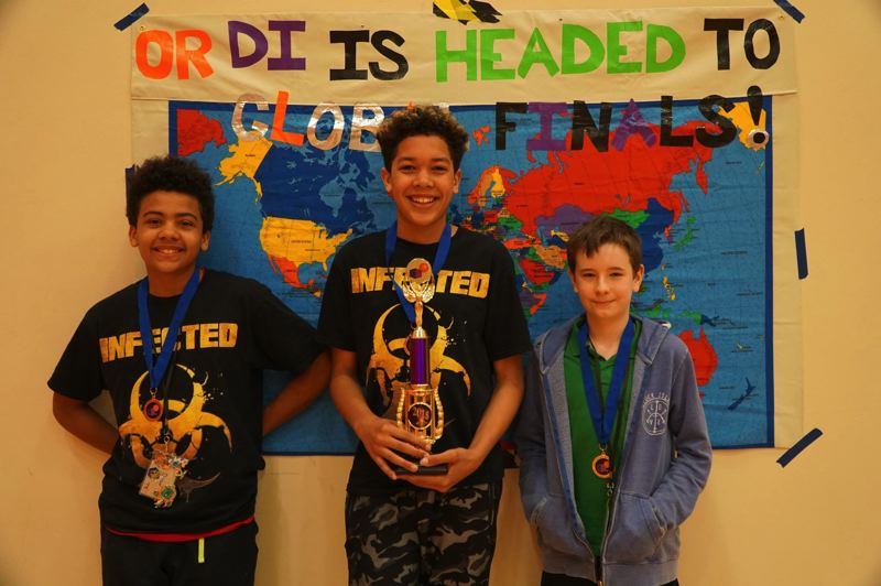 SUBMITTED PHOTO - Alliance Charter Academy sixth graders Deon Best, Isaiah Preuitt and Ben Snyder are all a part of a Destination Imagination Team called TF (The Future) that took first place at the Oregon State Tournament.