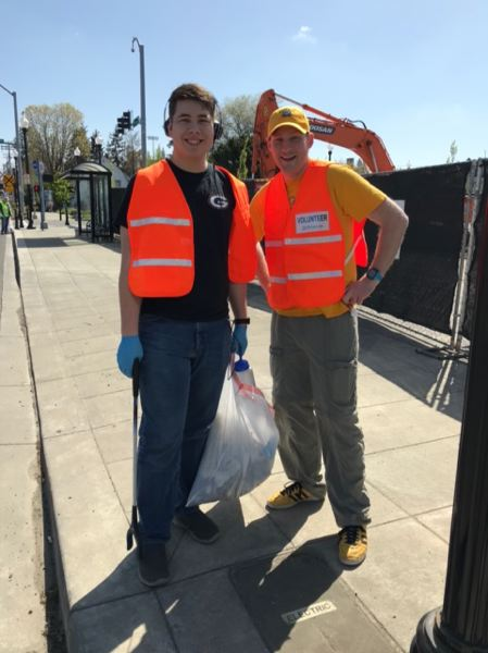 The Gladstone High robotics team joined forces with Nerds on the Go, a Milwaukie computer repair company. Together they helped with a Main Street cleanup in Milwaukie on Earth Day, April 22. Pictured are student Billy Siegle and Nerds on the Go owner Rory Dunnaback.
