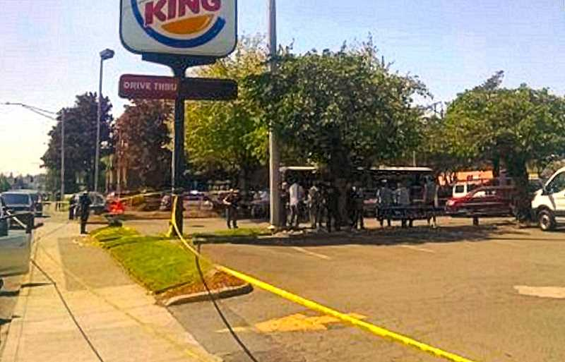 COURTESY KOIN-TV-6 NEWS - This photo of the taped-off scene at the Mall 205 Burger King parking lot was taken by KOIN-TV-6 news personnel shortly after the incident took place.