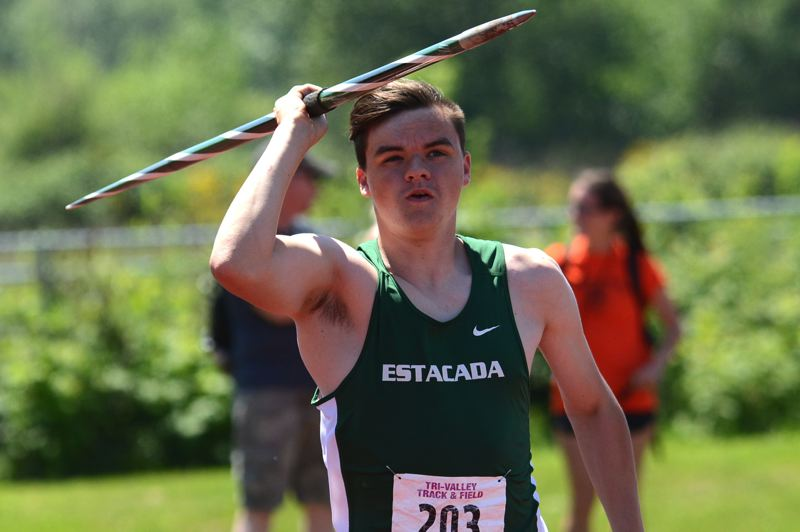 ESTACADA NEWS: DAVID BALL - Estacadas David Stamm starts down the runway on his way to a win in the javelin where he had the days best three throws.