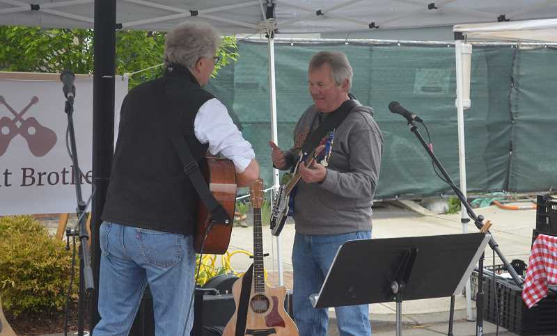 TANNER RUSS - Music is a big part of the Canby Farmer's Market each Saturday.