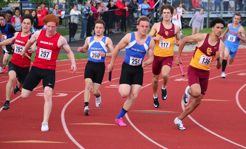 PAMPLIN MEDIA: JIM BESEDA - Central Catholic's Korbin Williams (136) opens a lead over Gresham's Nathan Luck (251) and Oregon City's Wyatt Lovell (297) on the third leg of the boys' 4x100 relay at the Mt. Hood Conference track and field championships at Gresham High School.