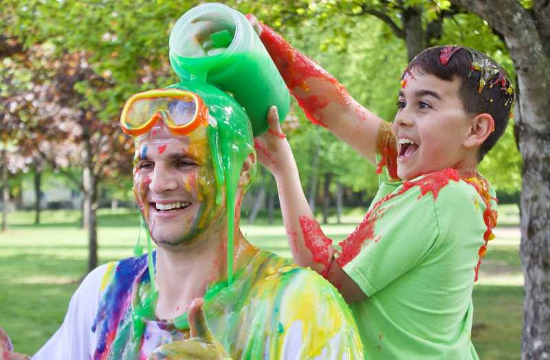 OUTLOOK PHOTO: CHRISTOPHER KEIZUR - John Olavarria had a blast dumping slime on his Family of Friends mentor Brandon McCullough in an effort to raise funds and awareness for the program.
