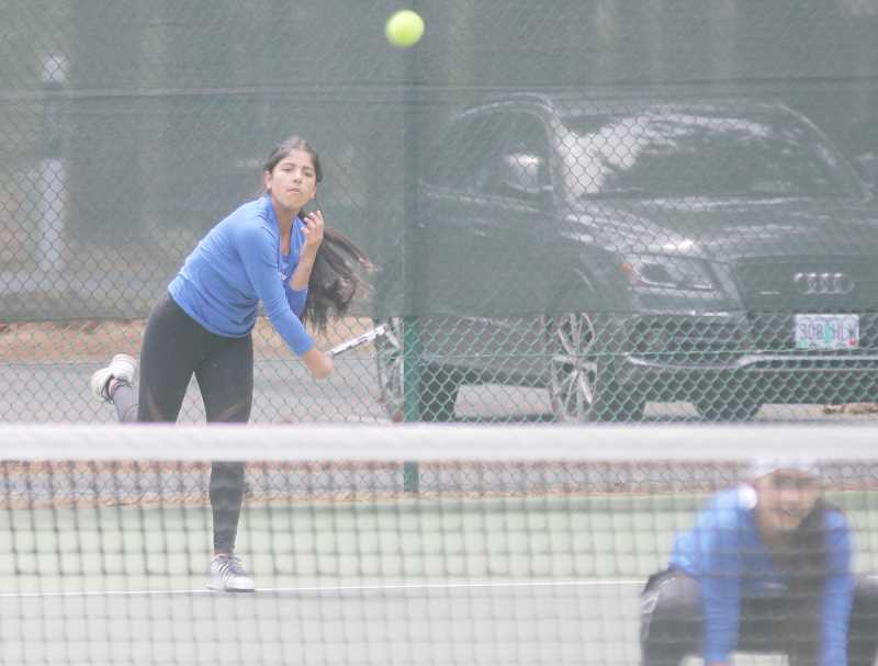 STEELE HAUGEN - Doubles team Erika and Jessica Olivera reach their goal, making it to state.