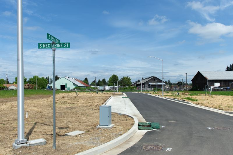 STAFF PHOTO: CHRISTOPHER OERTELL - The roadways in the Emmert's River West development are all but complete. Sidewalks and street trees will be installed at the same time houses are built, according to Cornelius city staff.