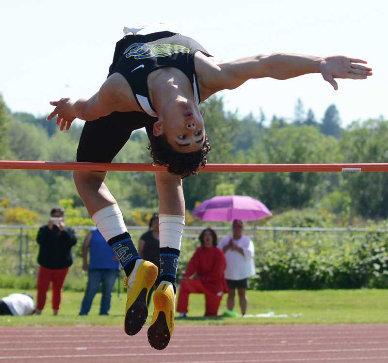 DAVID BALL/GRESHAM OUTLOOK - Dominic Langley clears 6-1 to win the high jump at the Tri-Valley Conference track & field championships, which were held Friday and Saturday in Molalla. Langley was named field event athlete of the meet.
