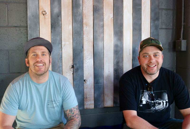 OUTLOOK PHOTO: ZANE SPARLING - From left, Jake Whitney and Jeff Pochop got their start working as bartenders. They now own five watering holes mostly in East Multnomah County.