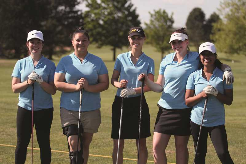 PHIL HAWKINS - The Woodburn girls varsity golf team, from left: Haley Elsasser, Maddie Castro, Efrosenya Toran, Bailey Woolley and April Vasquez.
