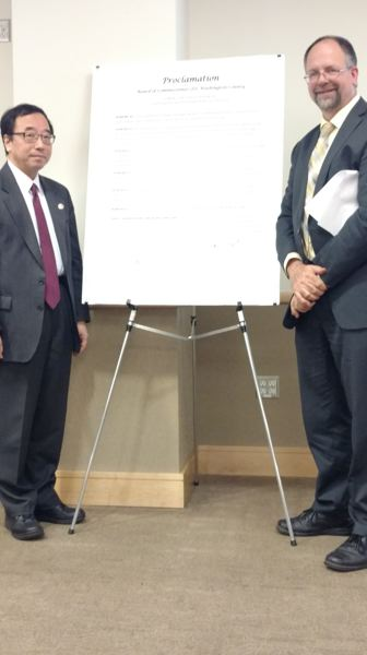 COURTESY WASHINGTON COUNTY - Takashi Teraoka, consul general of Japan based in Portland, left, and Washington County Board Chairman Andy Duyck with a display copy of a proclamation of Asian and Pacific Islander Heritage Month.