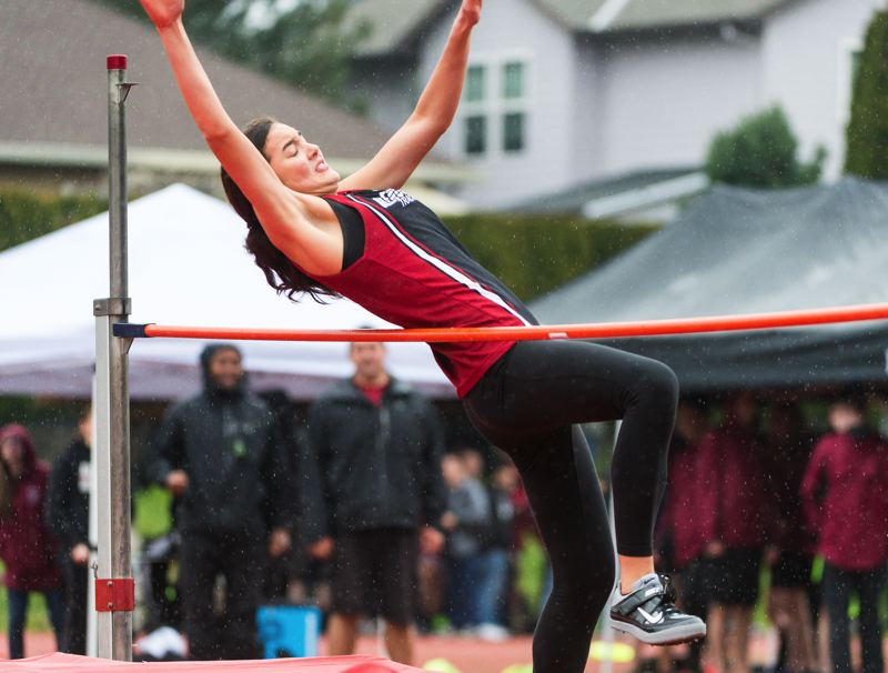 STAFF PHOTO: CHRISTOPHER OERTELL - Glencoe's Jayda Lee high jumps at the Metro League District Track and Field Championships at Liberty High School.