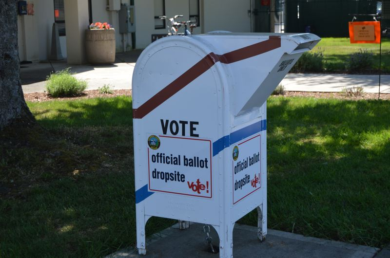An election ballot drop off box outside the Scappoose City Hall