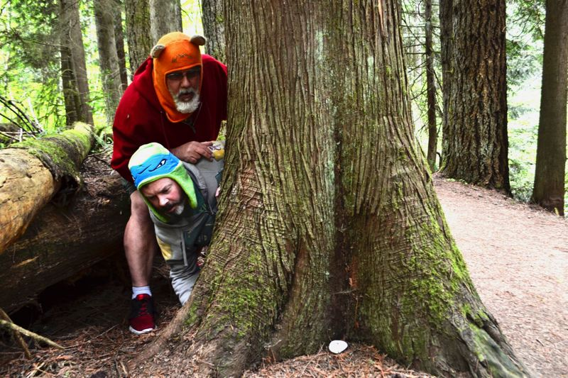 POST PHOTO: BRITTANY ALLEN - After finding their first Sandy Rock on the Tickle Creek Trail, Bryan Hackler and his friend Berny Richardson inadvertantly gave a new purpose to their weekly walks.