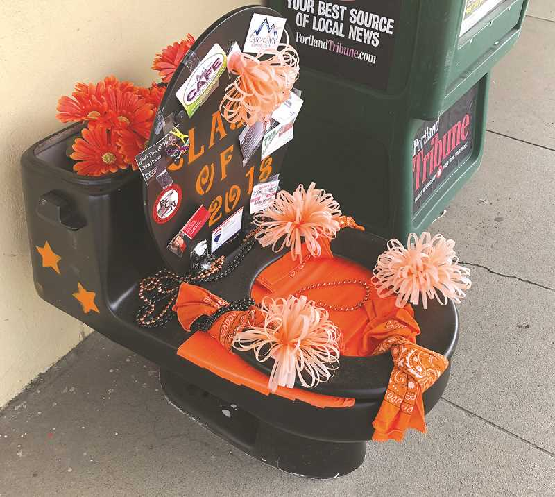 PIONEER PHOTO: LINDA BAKER - The MHS spirit toilet made its way to the Molalla Pioneer office.