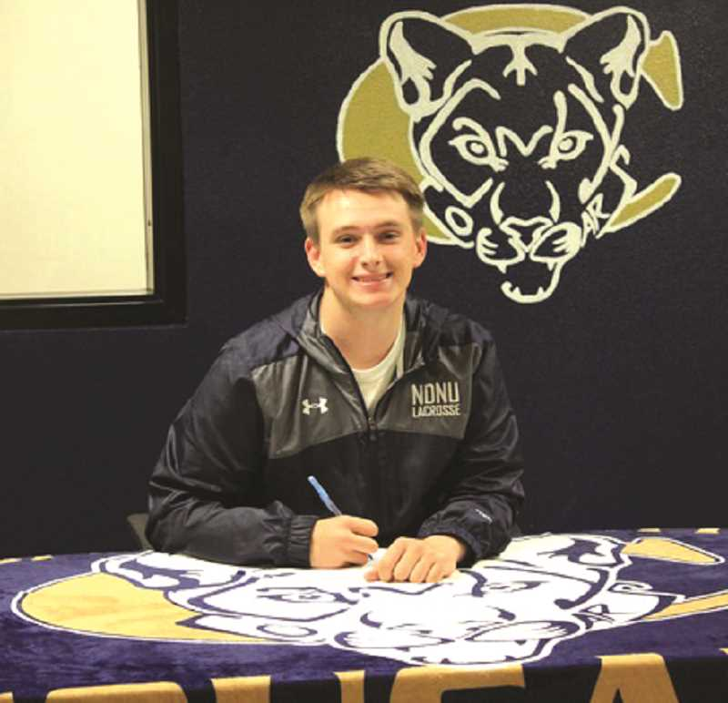SUBMITTED PHOTO - Garrett Netter signs with Notre Dame de Namur to play for the lacrosse team as a goalie.