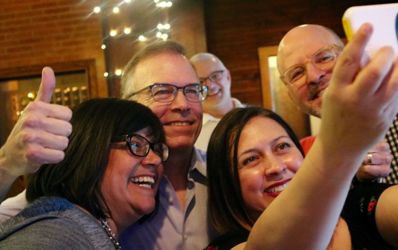 TRIBUNE PHOTO: ZANE SPARLING - Commissioner Nick Fish takes a selfie with supporters after seeing early returns on Tuesday, May 15 at Carmella's Lounge on Southeast Water Avenue.