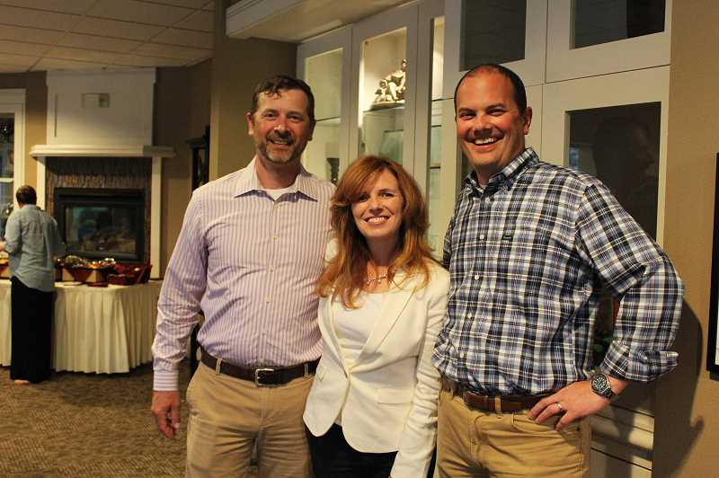 HERALD PHOTO: KRISTEN WOHLERS - Christine Drazan celebrated with family and friends Tuesday night. She is pictured with Rick Thomas (left) and her husband Dan Drazan (right).