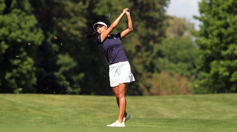 REVIEW PHOTO: MILES VANCE - Lake Oswego senior Tya Seth his a fairway shot on Tuesday during her victory at the Class 6A state tournament at Trysting Tree Golf Club in Corvallis on Tuesday.