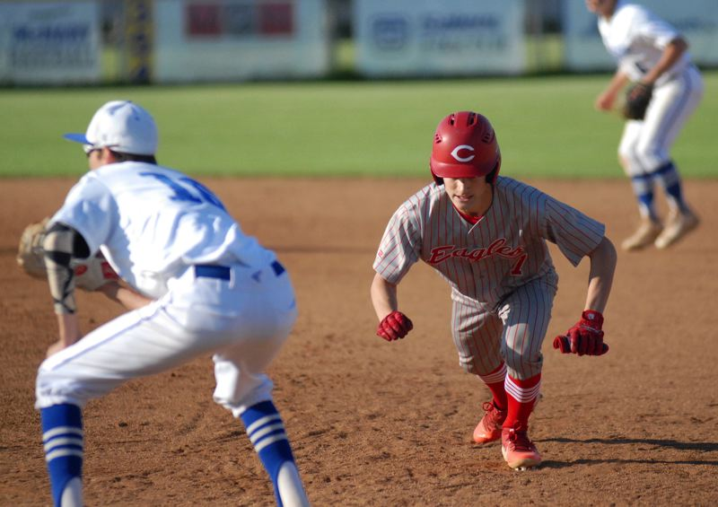 GRESHAM OUTLOOK: MATT RAWLINGS - Kyle Fitzgerald dives back to first base in Centennial's 15-11 victory over McNary.