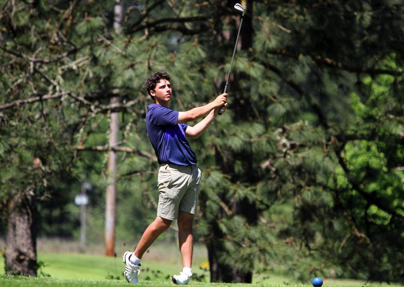 REVIEW PHOTO: MILES VANCE - Lake Oswego junior Peter Bouchard watches his tee shot fly during Monday play in the Class 6A state golf tournament at Emerald Valley Golf Club in Creswell.