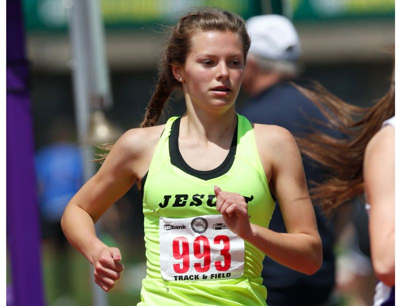 TRIBUNE FILE PHOTO: JONATHAN HOUSE - Makenna Schumacher, a junior at Jesuit High, is part of a running family, but her father, Jerry, who coaches distance stars for Nike's Bowerman Track Club, says he didn't push his children into the sport.