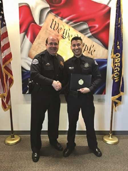COURTESY PHOTO: CITY OF WOODBURN - Woodburn police Chief Jim Ferraris congratulates Juan Morales, WPD's newest officer, on graduating from the police academy May 11.