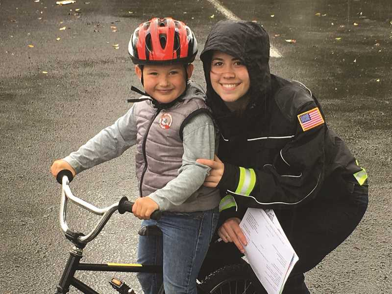 COURTESY PHOTO: WOODBURN FIRE DISTRICT - Bicyclists from ages 5-16 are taught bicycle safety at the annual bike rodeo at Walmart.