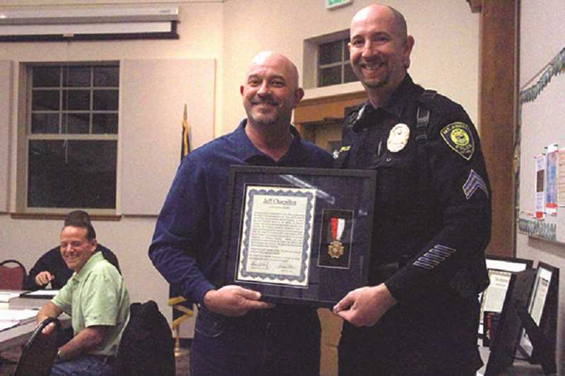 INDEPENDENT FILE PHOTO - Jeff Charpilloz, who is now suing the city of Mount Angel and its city manager, was awarded a Lifesaving Award at a March 2017 Mount Angel City Council meeting by Mayor Andy Otte.