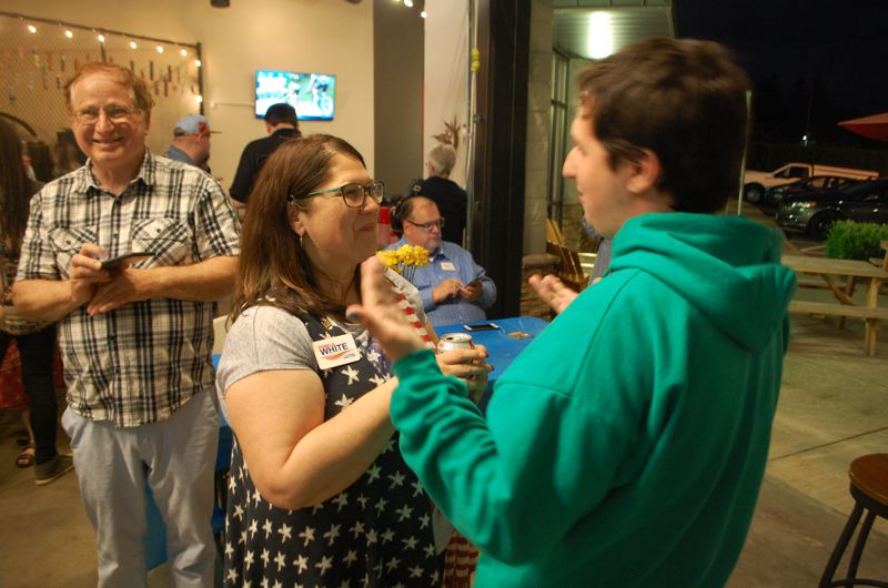 PHOTO BY: RAYMOND RENDLEMAN - Pamela White, Clackamas County clerk candidate, celebrates the May 15 election results with supporters at 12 Bridge Ciderworks in Oregon City.