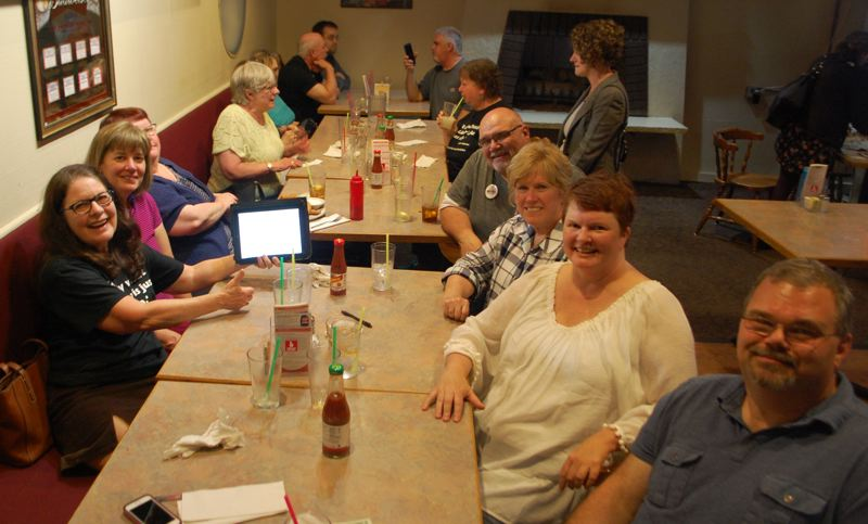 PHOTO BY: RAYMOND RENDLEMAN - Supporters of the measure to authorize a library in Gladstone to be operated by the county gather at Stanley's Corner to celebrate the May 15 election results.